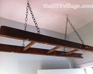Antique ladder doubles as a drying rack for a laundry room. This is awesome!