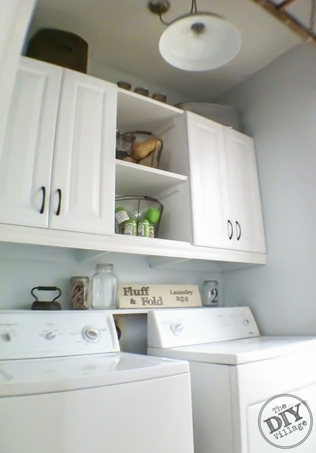DIY Laundry Room makeover. I love these cabinets and the shelf between them. Gives functional and attractive.
