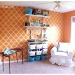 Orange and aqua craft room