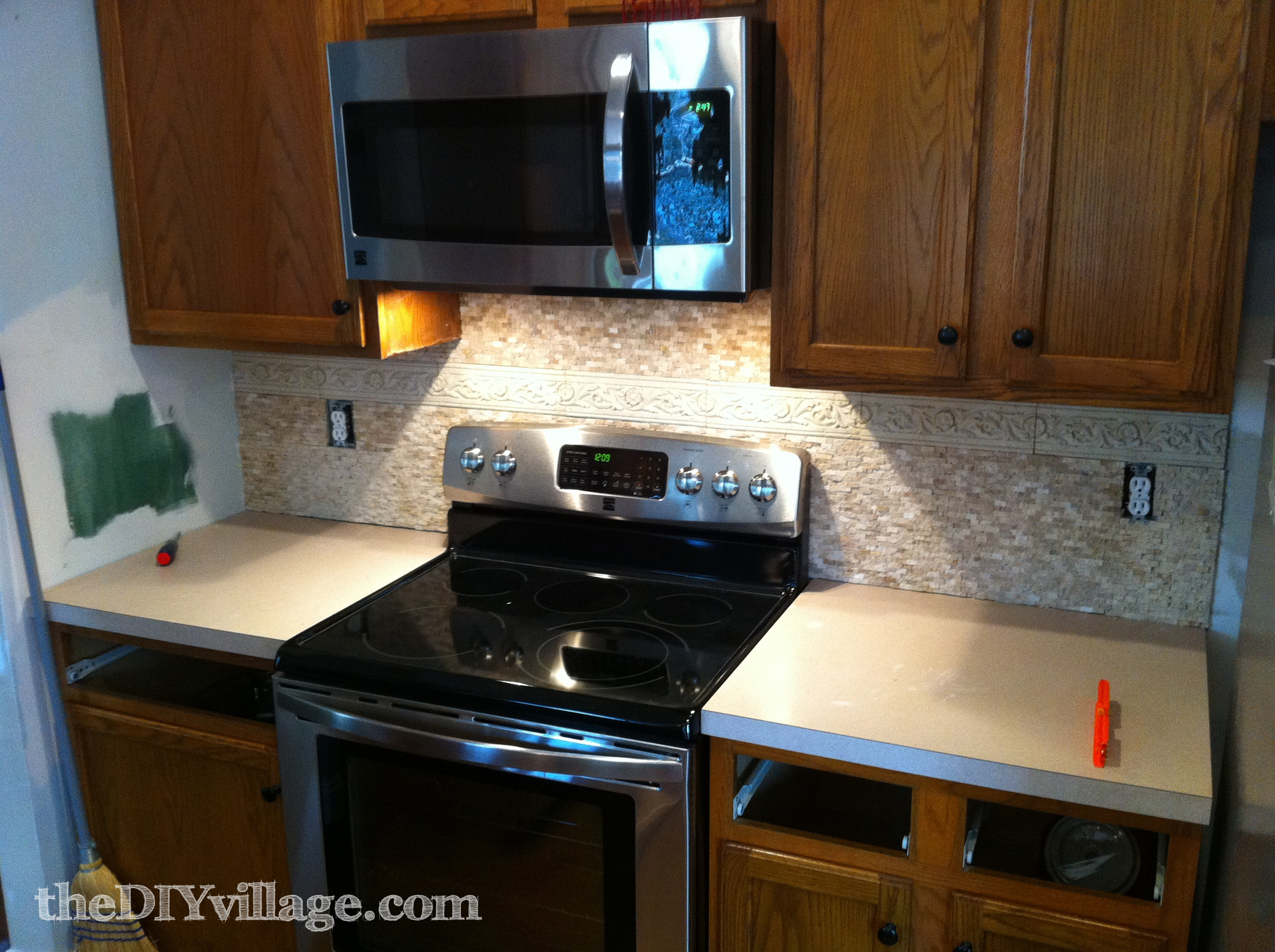 Split face travertine tile backsplash the diy village installing split face travertine tile dailygadgetfo Choice Image