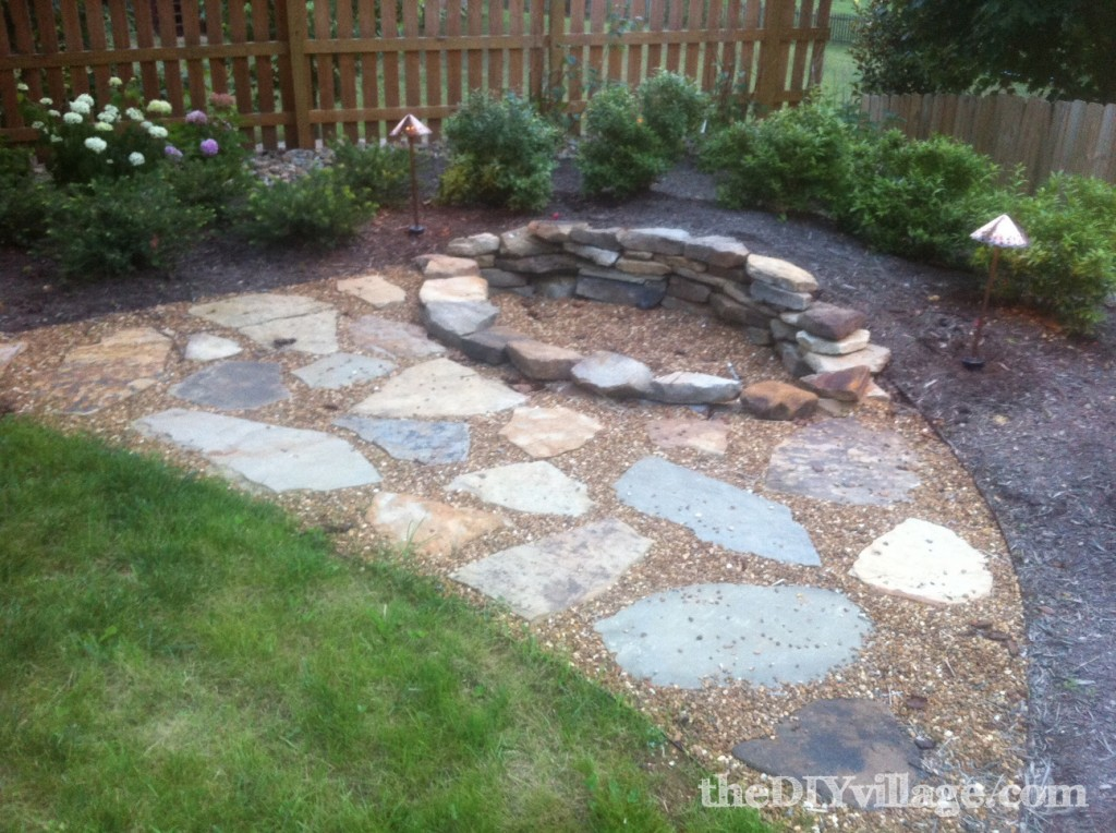 Building a stacked stone fire pit the diy village for Step by step fire pit