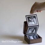 Box with tri-fold pictures that pull out with ribbon