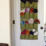 Over the Door Organizer for Winter Accessory Storage by: theDIYvillage.com