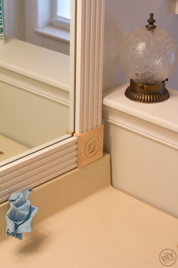 how to frame bathroom mirror with molding a bathroom makeover on a budget the diy 26096