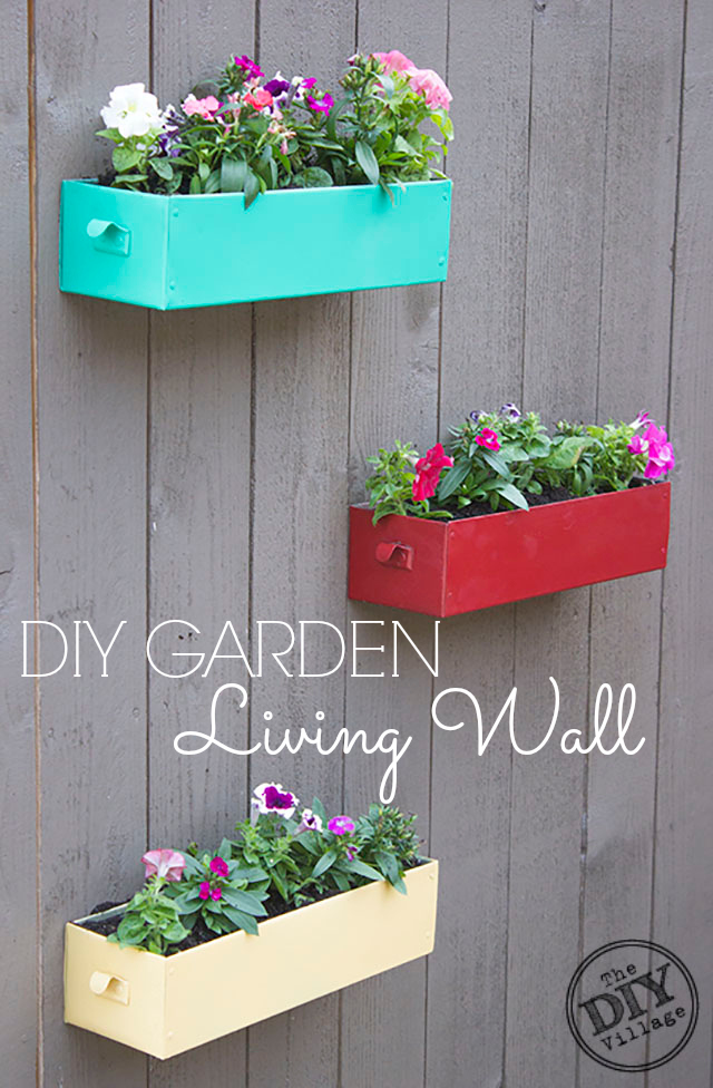 DIY Living Wall for your garden can be enjoyable year round depending on the types of plants that you use in the containers.