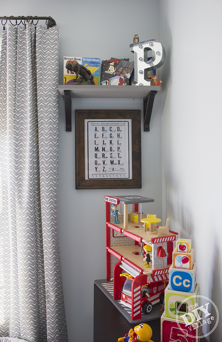 Modern Rustic baby nursery with bright pops of color and custom Alphabet Art.