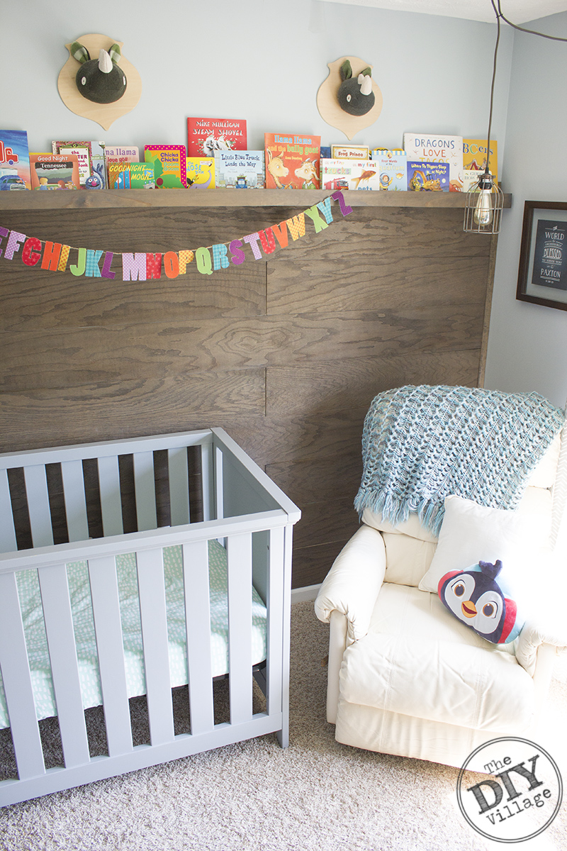 Modern Rustic baby nursery with bright pops of color and custom book ledge