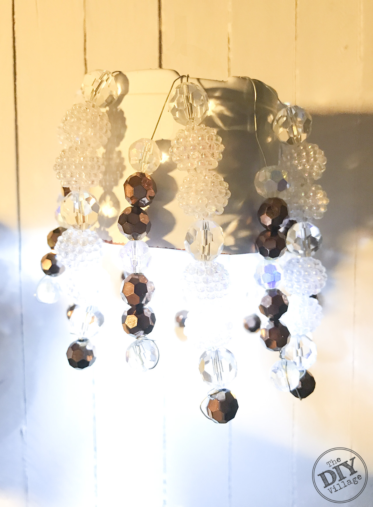 Diy locker chandelier for the crafty girl the diy village adhere the magnets to the top of the pot let them dry over night the next day your diy locker chandelier is ready to hang in your locker arubaitofo Images
