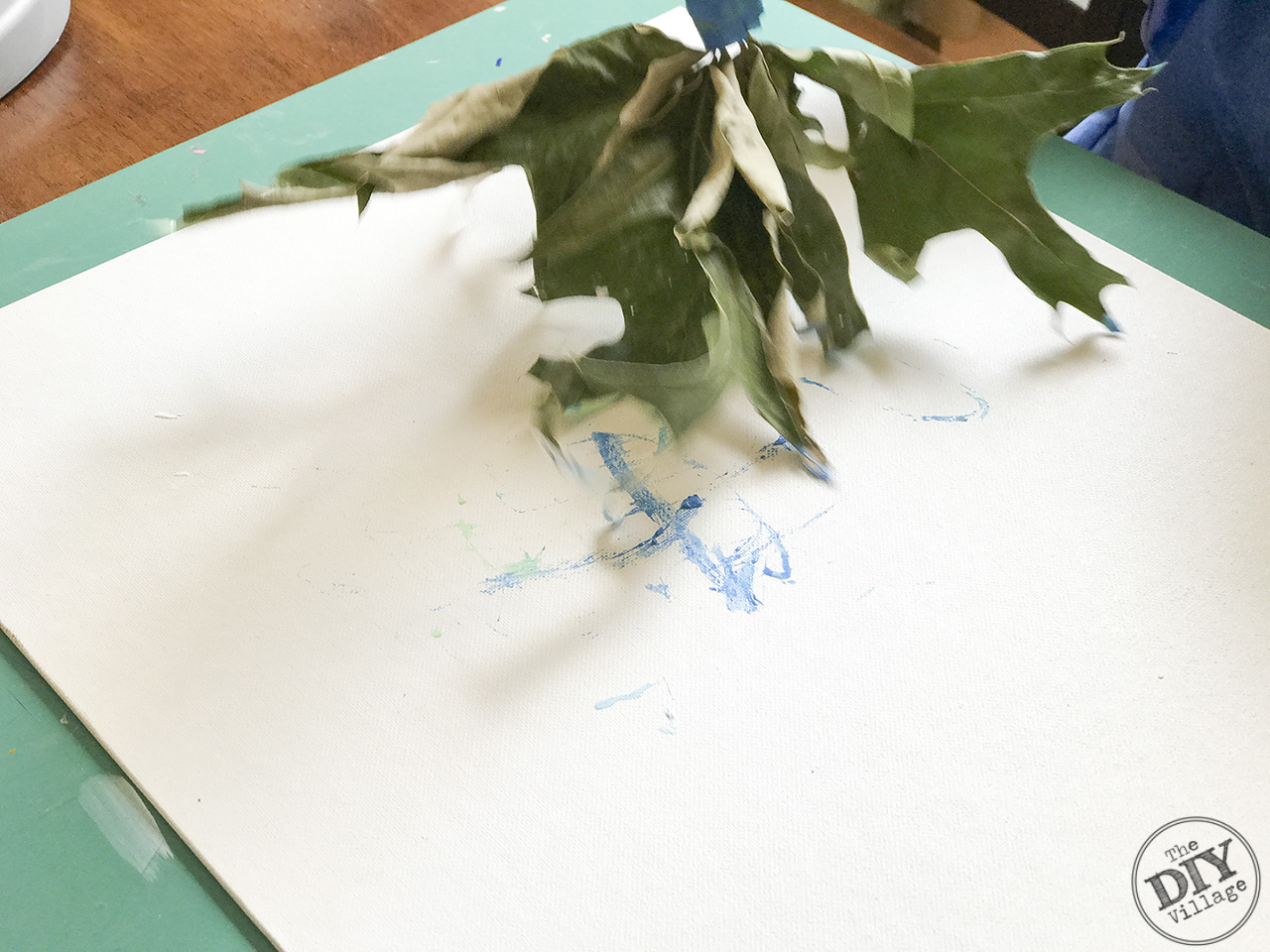 Creating art with kids doesn't have to be boring. Explore textures and different media by using found objects to paint. Leaf paint brush art is a great way to experiment.