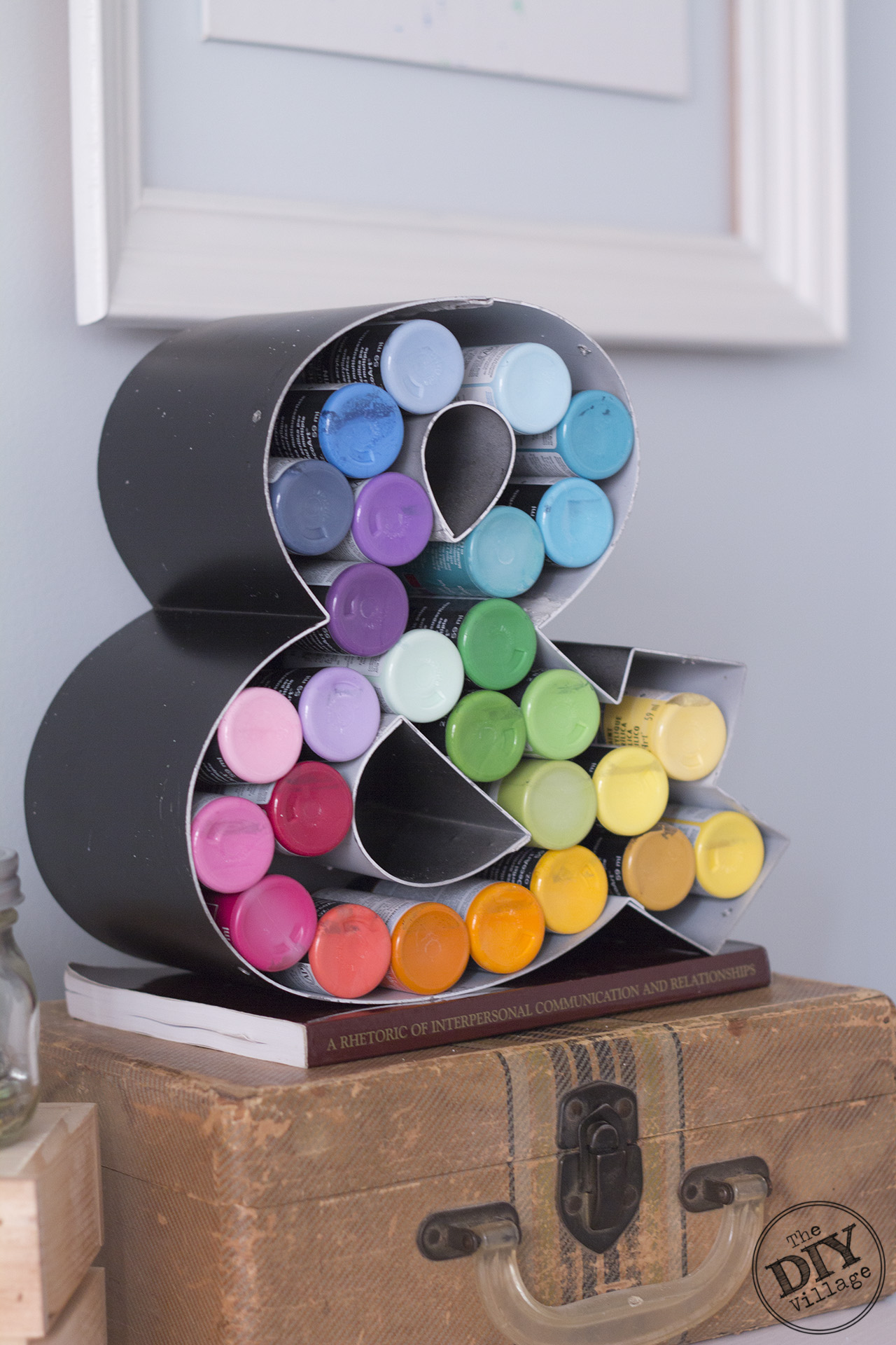 Super creative craft paint storage.