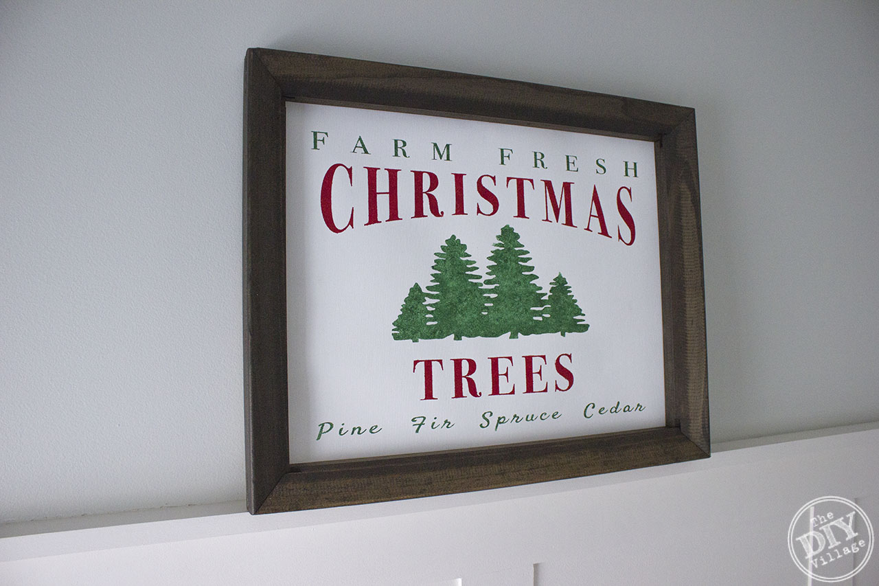 Creating your own framed canvas art has never been easier. Step by step process of how to create a custom DIY Farm Fresh Christmas Tree Sign