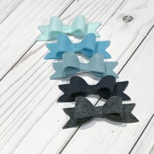 Small felt bows in shades of blues and grays