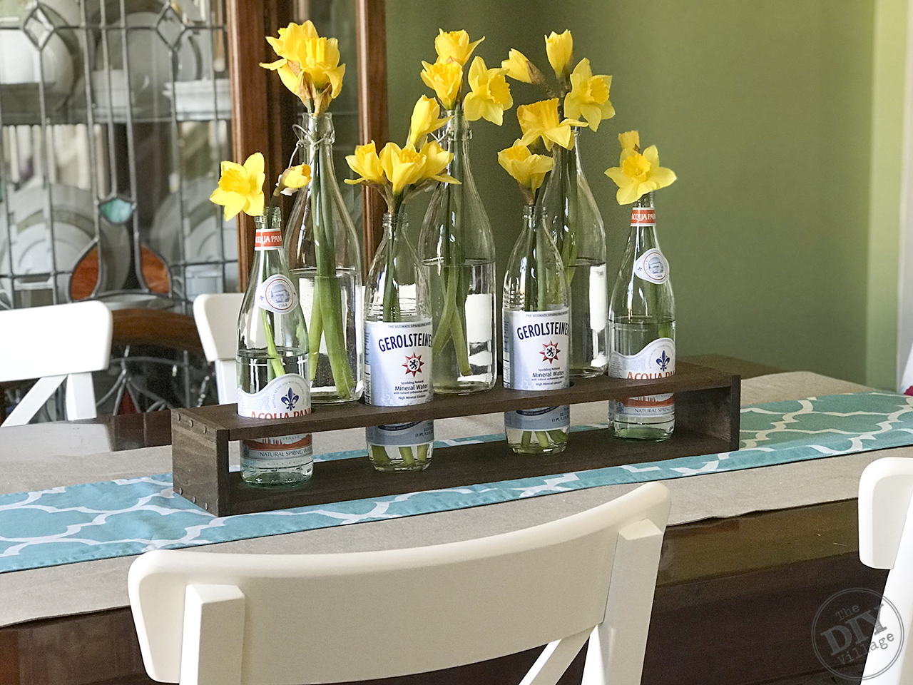 Easy DIY Bottle Vase Holder with nailhead trim