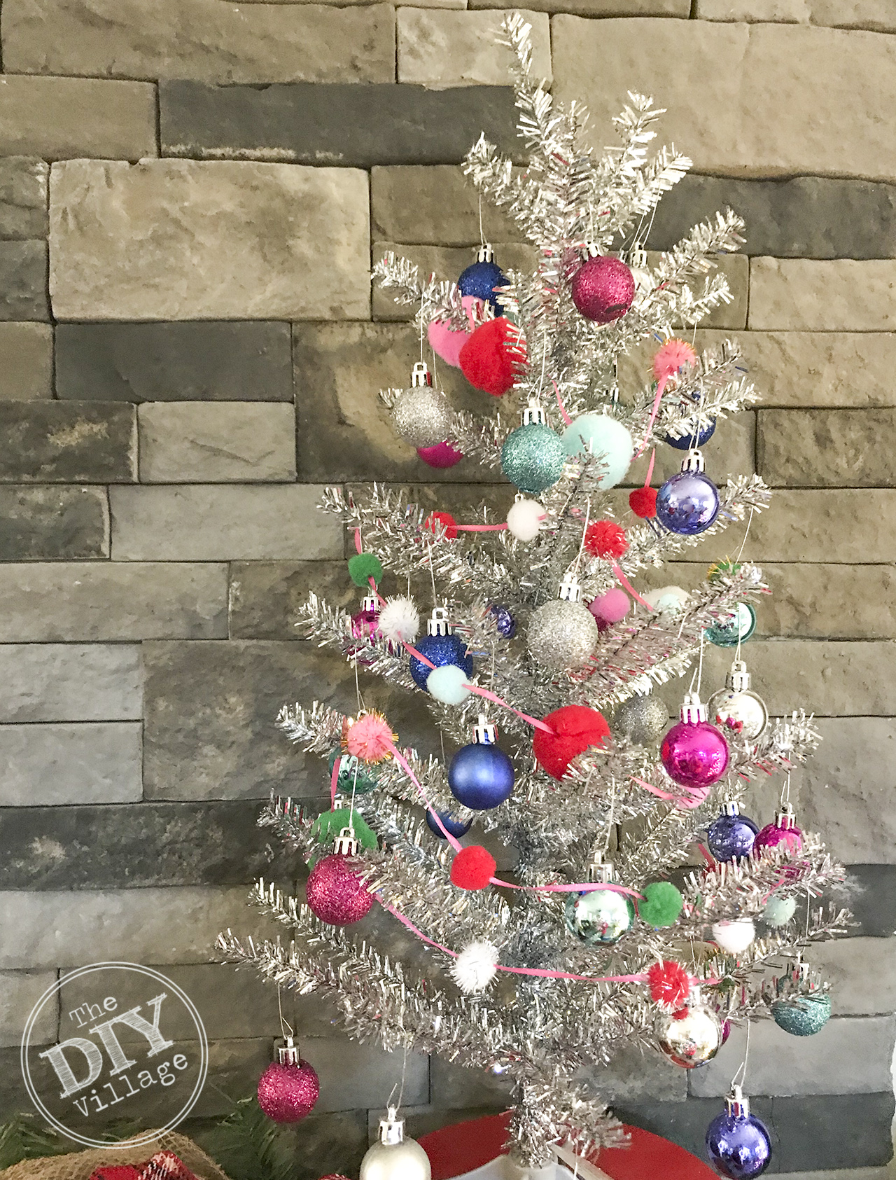 Easy DIY pom pom garland with dollar store items. #pompom #garland #diy #christmas